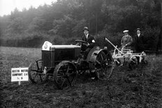 Austin tractor and plough 1920s